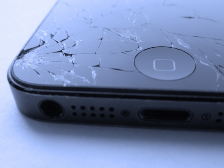 A touch screen mobile phone with broken screen Stock Photo