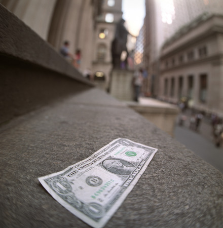 federal hall: One dollar note lying alone on the steps of the Federal Hall