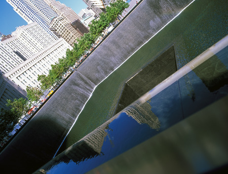 dolor: New York City, USA - June 24, 2014: 911 Memorial at Ground Zero, Lower Manhattan, commemorating the terrorist attack of September 11, 2001. Names of victims engraved in the bronze parapet.