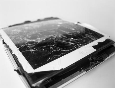 broken up: Tablet computer with broken touch screen.