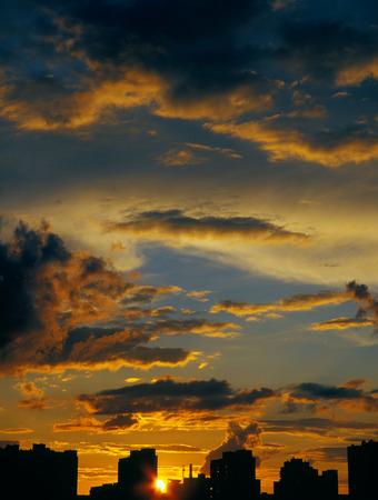 Beautiful sunset over a dark cityscape. Stock Photo