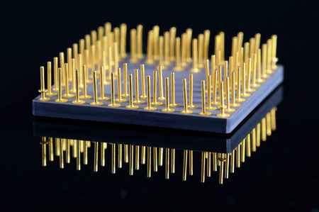 information extraction: Close-up view of CPU on black background.