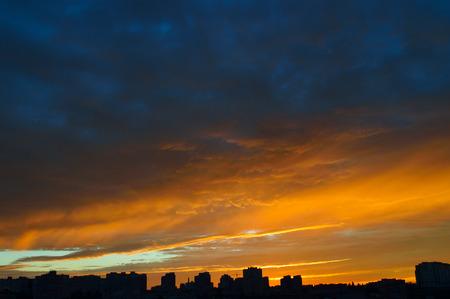 orange sunset: Beautiful orange sunset over a dark cityscape.