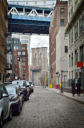 manhattan bridge: The tower of the Brooklyn Bridge and a fragment of the Manhattan Bridge. Stock Photo