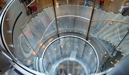 spiral staircase: Element of modern design - glass spiral staircase. Stock Photo