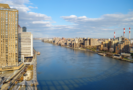queensboro bridge: View of East River with shadow of the Queensboro Bridge from the Roosevelt Island Tramway.