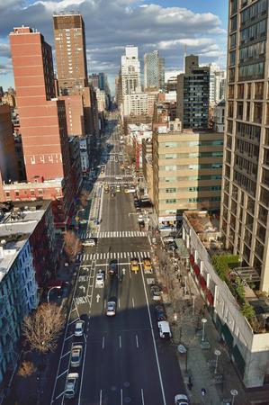 queensboro bridge: NYC streets. Midtown Manhattan - 1st Ave near Queensboro Bridge. Editorial