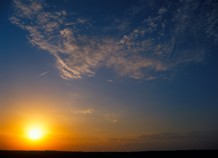 dark landscape: Sunset over a dark landscape. Useful as background for your projects.