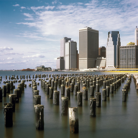 downtown manhattan: Old pier pylons and Downtown Manhattan, New York City.