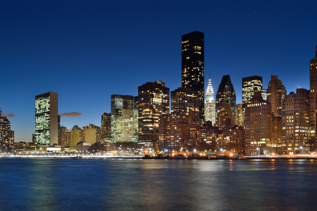 A night view of the New York City skyline from Roosevelt Island.