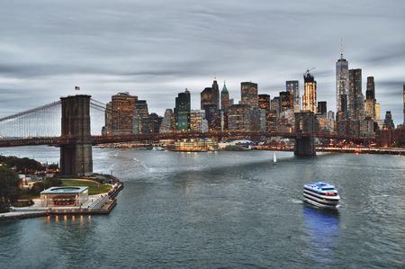 Manhattan skyline with Brooklyn Bridge at evening - HDR image.