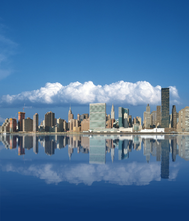 Midtown Manhattan skyline reflected in the waters of the East River. Aspect ratio 6 to 7. Stock Photo