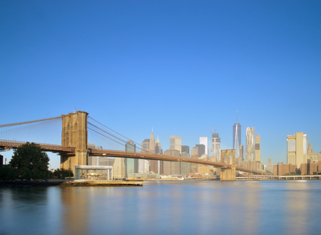 Manhattan skyline with Brooklyn Bridge - long exposure image.