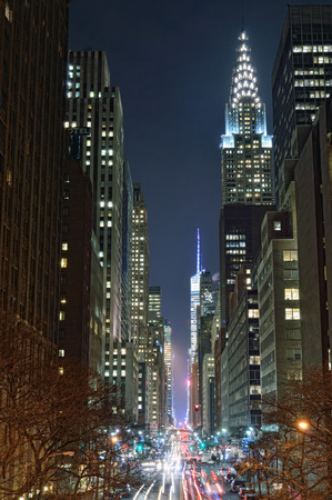 42nd: NYC streets at night. Midtown Manhattan - 42nd Street with Chrysler Building.