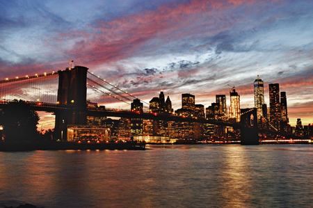 Manhattan skyline with Brooklyn Bridge at sunset - HDR image. Stock Photo
