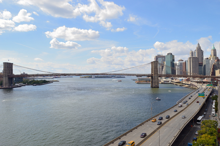 East River with Brooklyn Bridge at sunny day.