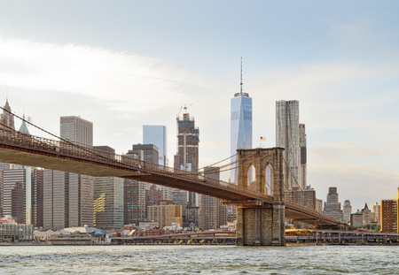 Manhattan skyline with Brooklyn Bridge and Freedom Tower. Stock Photo