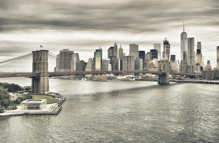 Manhattan skyline with Brooklyn Bridge at twilight - HDR image.
