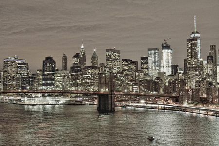 HDR view of Lower Manhattan with Brooklyn Bridge at night. Stock Photo