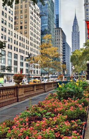 New York City, USA - September 21, 2016: Streets of Manhattan. 42nd Street with Chrysler Building - view from the Bryant Park.