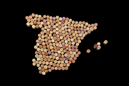 Wine-producing countries - maps from wine corks. Map of Spain on black background. Clipping path included.