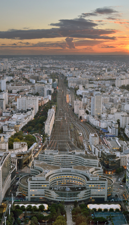 france station: Aerial view of Paris with Gare Montparnasse at sunset. Editorial