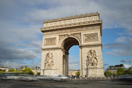 Arc de Triomphe against a blue sky, taken with long exposure. Editorial