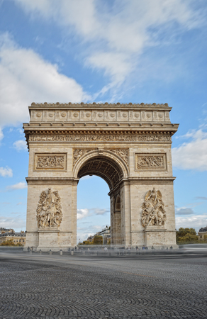 Arc de Triomphe against a blue sky, taken with long exposure. Stock Photo