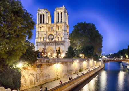 HDR view of Notre Dame de Paris at evening.