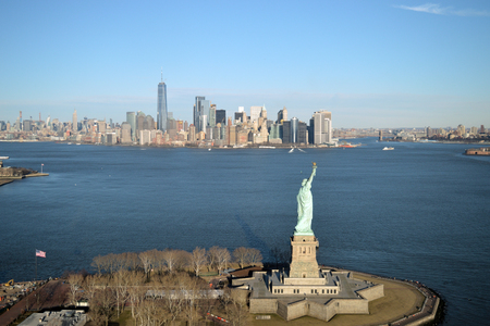 Aerial view of Liberty Island with Statue of Liberty and Manhattan. Stock Photo