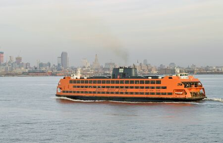 New York City, USA - February 3, 2019: Staten Island Ferry on the East River.