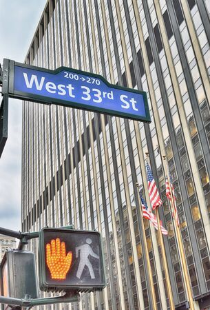West 33rd Street sign in New York City, USA.