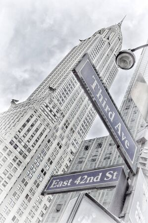 East 42nd Street and Third Avenue street sign in New York City, USA.