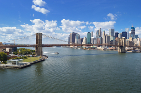 East River panorama with Brooklyn Bridge at sunny day.