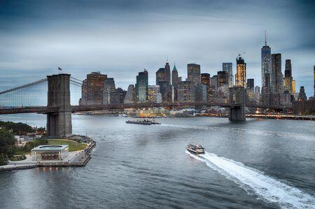 Twilight view of Lower Manhattan with Brooklyn Bridge. Stock fotó