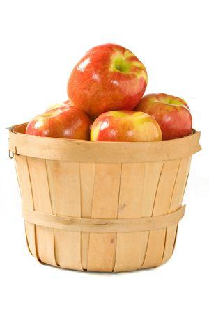 bushel: Crisp fall apples in a small wooden bushel.