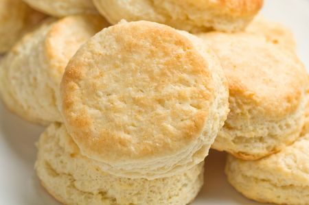 Light tasty golden homemade buttermilk biscuits arranged on rectangular platter. Stock Photo - 4306249