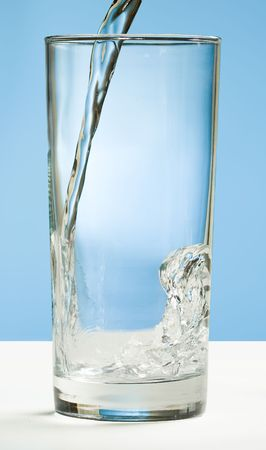 Cold refreshing water poured into a tall glass