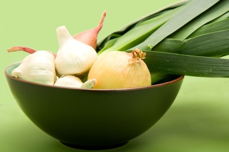 Onion, Garlic, Shallot, and Leek in Bowl on Green Stock Photo - 4528039