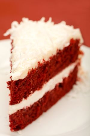 red velvet cake with coconut on red