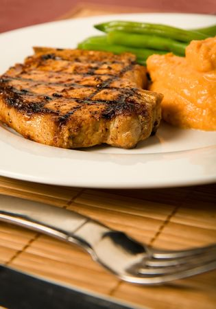 criss: Grilled pork chop served with green beans and mashed sweet potatoes