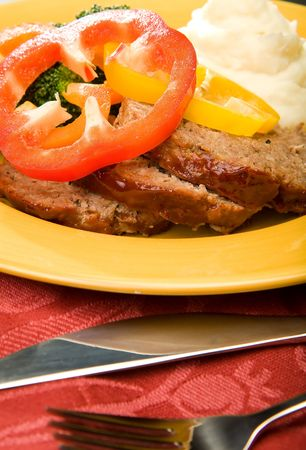 meatloaf with mashed potates and broccoli garnished with pepper rings and glaze Stock Photo - 4811991
