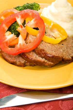 meatloaf with mashed potates and broccoli garnished with pepper rings and glaze Stock Photo - 4811997