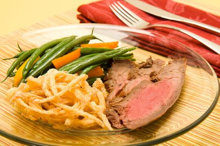 flank: sliced flank steak served with french green beans and crispy fried onions