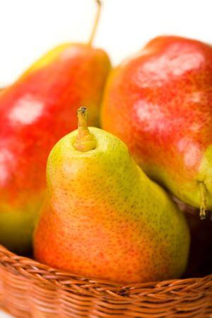 Forelle pears in wicker basket Banco de Imagens
