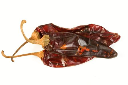 papery: Three guajillo chiles isolated on white