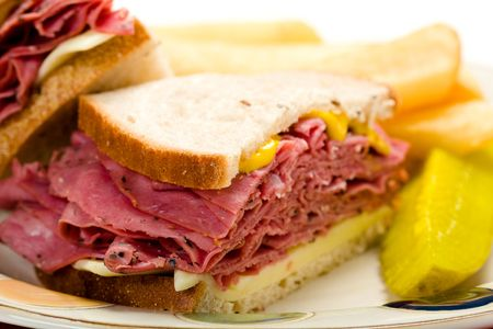 pastrami sandwich with thick french fries and pickle