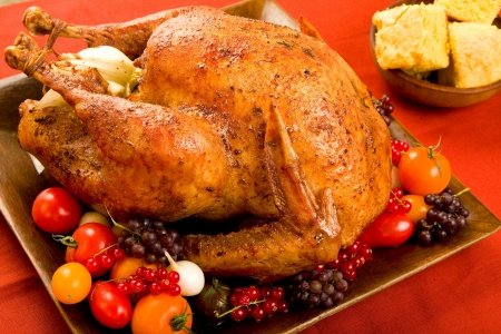 Roast Turkey stuffed with flavorful vegetables. photo