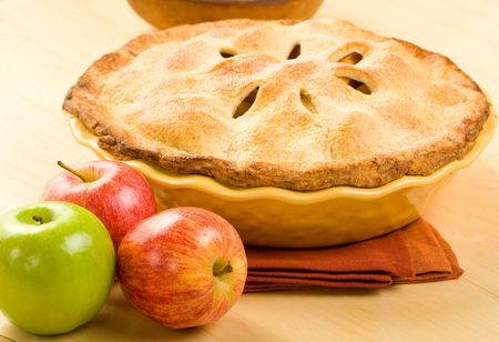 Whole apple pie in yellow baking dish on wood surface Stock Photo - 5345083