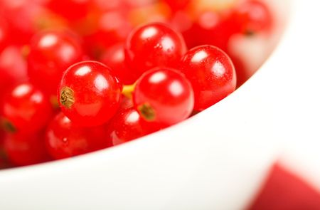 Bright red currants in white bowl